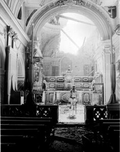 WWII - Pvt. Paul Oglesby, 30th Infantry, standing in reverence before an altar in a damaged Catholic Church. Acerno, Italy.