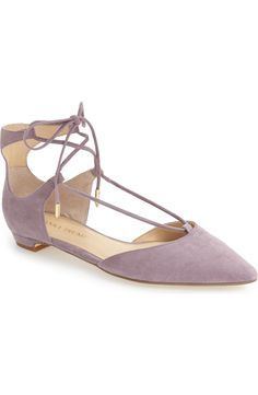 Delicate ghillie lacing bridges the instep and crisscrosses up the ankle on this pointy-toe flat in a pastel purple with a gladiator-inspired silhouette.