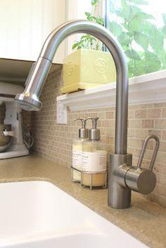Faucet from Costco. (Remodelaholic) Everywhere Beautiful faucet backsplash