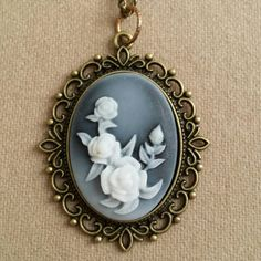 Check out this item in my Etsy shop https://www.etsy.com/listing/239095162/large-resin-roses-cameo-pendant-necklace