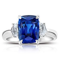 Blue Sapphire and Diamond Ring - in Platinum - (0.49 CTW)