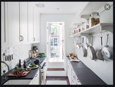 White or white grey walls, white or grey cabinets, grey dark or mid grey counter top. Vinyl wood effect flooring, or long porcelain wood effect flooring, grey with a touch of warmth......