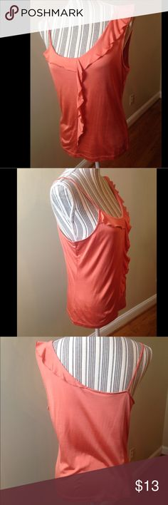 The limited ruffle tank Sz Large NWTs. New w/tags This blouse is pre owned gently used but in great condition . No stains or rips. It measures 18 inches from armpit to pit. Making it 36 inches across. The length is 23 inches long...Lined in the inside..I take care of all my items and value every customer. Clothes are stored in a clean and smoke free environment. As I want your item to arrive to you on time, I ship fast. The Limited Tops Tank Tops