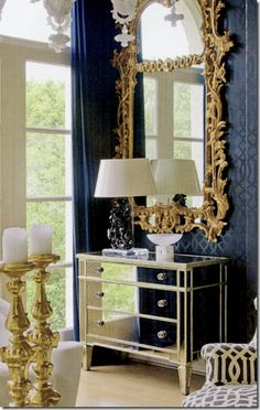 one of the pair of mirrors and the mirror chest.