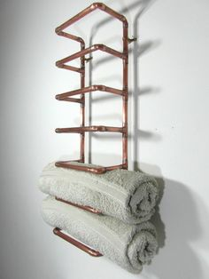 Bent Copperz - put a bit of industrial French justice into your home with this hand crafted copper pipe towel rack. Reclaimed copper piping in 0.7 or 16 mm, soldered together for maximum strength. This towel rack accepts 6 rolled up towels and can be free standing or be hung on the wall. 4 brass coloured wall fittings are provided with your order.  The unit is made from reclaimed French copper, cleaned up and silver coloured solder. The product has been varnished using a high quality, light…