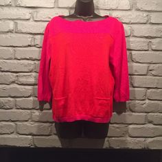 SALE! a.n.a pink and orange sweater Size large. Very soft and comfortable. Two front pockets. The colors are pink and orange. My camera had a hard time picking up the orange color and it looks more red in the photos. This is very cute and in excellent condition. a.n.a Sweaters Crew & Scoop Necks