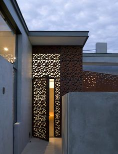 modern glass doors, overlay of perforated sheet of Corten steel, concrete home, contemporary desert design by Steven Holl Architects Wood House Design, Door Design, Exterior Design, Interior And Exterior, Steven Holl, Architecture Details, Interior Architecture, Skylight Design, Entrance Doors