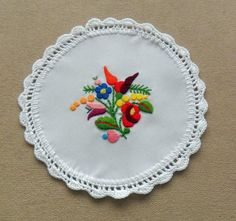 Hand-embroidered doily with hand-crocheted white borders (Kalocsa style)