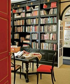 Built in book case with library sconces