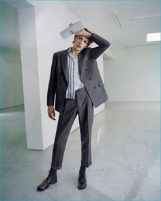 Model Finnlay Davis dons a double-breasted Brunello Cucinelli suit with a vintage tank and shirt with John Alexander Skelton leather boots.