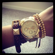Michael Kors Stacked Wrist, watch and bracelets.