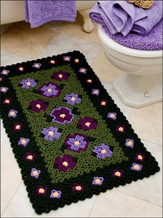 wiggle wiggle wiggle...stitch!!!    Ravelry: Flowers Rug pattern by Susan Lowman