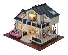 Amazing DIY Dollhouse kit - perfect gift for little girls. She will love the lights, furniture and car - all included.
