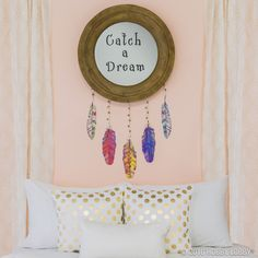 Catch some Z's under your very own DIY dream catcher! 1. Adhere quote to mirror following directions on wall decal packaging (258608). 2. Carefully hang up mirror (1130442). 3. Place feather decals (1220003) on wall below mirror to create dream catcher effect. 4. Braid leather cording (515115/515072), adding beads (240382/240317) sporadically, and tie knots at ends. Attach cording from the bottom or back of mirror and to feather decals.