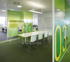 Graphics on glass. THE PENINSULA IDSRSHEPPARD ROBSON MANCHESTER 2010 GREEN GLASS WALL AND DOORWAY TO MEETING ROOM