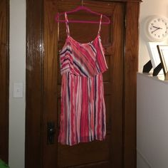 Effortless sun dress. 100% Polyester. Approx 41 inches in length. Adjustable straps. This item was true to size. May be junior sizing. Not sure. Fit great on my size 16 body at the time. Dresses