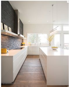 Again, too modern but demonstrates good storage while being a very open kitchen... No cabinets on top just LOTS of draws