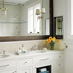 Like the barnwood frame around the mirror. Remodeled second floor bathroom of the Miller Pelaez home