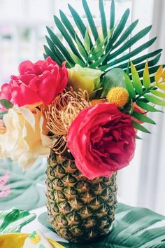 You won't believe this show-stopping centerpiece! Grab a bunch of pineapples, hollow them out, and use them as a vase for some tropical flowers. Scatter them about your dessert table or use them as centerpieces. Either way, they are a stunning party decoration. See more party ideas and share yours at CatchMyParty.com Luau Theme Party, Hawaiian Luau Party, Moana Birthday Party, Birthday Parties, 2nd Birthday, Flamingo Pool, Flamingo Birthday, Tropical Party Foods, Pineapple Centerpiece
