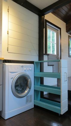 An 8×30 Tiny Home on Wheels with floor storage and two lofts. $63,000