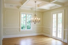 Suzie: Tiek Built Homes - Beautiful buter yellow dining room design with coffered ceiling, ...