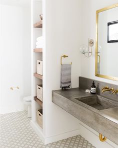 Patterned+tiles+and+floating+concrete+sink+--+Studio+McGee.jpg design by studio McGee Inspirational bathroom decor, Bathroom Closet, Bathroom Renos, Bathroom Interior, Modern Bathroom, Bathroom Goals, Bathroom Ideas, Bathroom Vanities, Gold Bathroom, Bathroom Layout