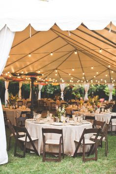 Like that it's casual on the grass, the chairs are natural wood with padding, the table cloth is off white and possibly linen, the heaters are scattered, the tent has sheer drapes and the centerpieces are small and simple. I would only add more lights up top.
