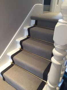 Stairs with golden rods Grey Carpet with Black Border and Golden Stair Rods to Stairs Carpet Staircase, Staircase Runner, Hallway Carpet, Hallway Flooring, Stair Runners, Stairs With Carpet Runner, Stairs And Hallway Ideas, Hallway Ideas Entrance Narrow, Modern Hallway