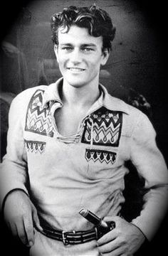 """young John Wayne.  Yes, that's right.  I put a Young John Wayne on my board because he is cute as all """"get out"""" and I wish more men were like him.  I like a Man's Man.... Now a days, guys wear lipstick and fingernail polish... why?"""