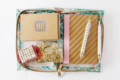 book clutch with stationary supplies