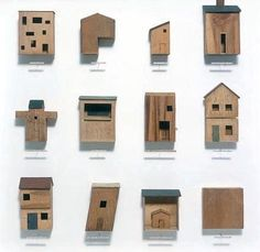 Tiny little houses modelled from found scraps of wood by Chris Kenny.