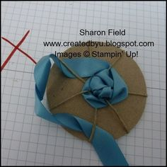 Be mindful to straighten out the ribbon as you tug it towards the center… the twist in the photo below is NOT good… see the big red X?