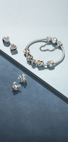 Add a touch of magic to your jewellery box with the new PANDORA Disney charms. Crafted with sterling silver, enamel and sparkling stones, they're inspired by iconic characters like Minnie and Mickey Mouse.