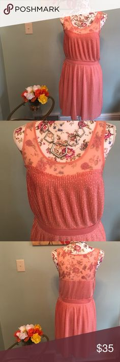 Beautiful size MED polka dot dress This dress is just completely adorable.  Previously loved but near perfect condition.  The netting at the top and polka dots make this so cute for any occasion! Great pleating detail on the skirt. Beautiful peach/coral color LC Lauren Conrad Dresses