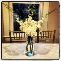 Esprit de Coeur- Wedding centerpeice comprised of white orchids and hydrangeas.