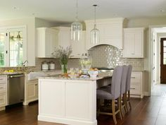 Cooper hood would be added and we could bring more color in with barstools -- Ivory Kitchen Cabinets - Transitional - kitchen - Bria Hammel Interiors Ivory Kitchen Cabinets, Kitchen Cabinet Colors, White Cabinets, Cream Cabinets, Kitchen Colors, Inset Cabinets, Kitchen Layout, Beautiful Kitchens, Cool Kitchens