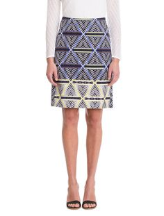 Made in our signature Stretch Canvas fabrication, the Geo Slim Skirt features a diamond geometric pattern with blue hues and neon green. Back zip closure and back hemline slit.