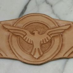 Close up details of the hand tooling of the SSR Eagle on the Agent Carter leather cuff. Can't wait to see Season 2! #TheLeatherGeek Corey Christopher