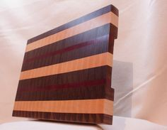 Heirloom Quality End Grain Cutting Board. This End Grain Butcher Block style cutting board is the ultimate cutting board for any kitchen or BBQ.