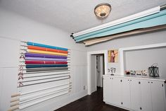 """Love Kris. Remember seeing this in your studio and couldn't remember how you did it     """"The one on the ceiling is from ebay. The one on the wall is homemade = ) It's two 1x4's with small pieces of a dowel glued into the diagonally drilled holes. Then aluminum tubing with pvc caps on the ends!"""""""
