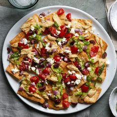 This vegetarian nacho recipe is a fun combination of two favorites--nachos and Greek salad. It uses whole-grain pita chips instead of the tortilla chips used in traditional nacho recipes, and it's loaded with the classic fresh vegetables in Greek salad as well as creamy hummus and salty feta cheese. And it doesn't even need the oven! Easily doubled, this makes a great appetizer or light dinner.