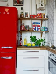 love this color red.  I have this door I want to paint.... and hang somewhere in my home.  This might be he color. I love the bright greens and yellows with it.  perfect for a fresh kitchen.