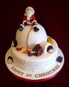 "Christmas igloo cake with Father Christmas, presents and penguins by #CakeyCake. 9"" traditional fruit cake with 6"" chocolate hemisphere igloo."