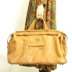 Vintage leather weekender bag, $220
