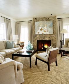 Cozy neutral living room with beautiful artwork - Traditional Home®