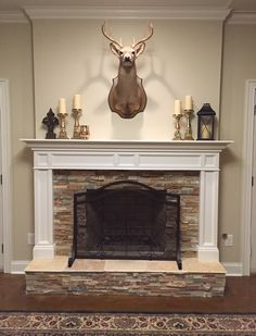 Deer, stone fireplace, mantle, stained concrete floors, basement, traditional mantle, stacked stone hearth, classic fireplace, BM Manchester Tan wall color