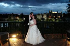 Wedding kiss with Leeds Castle in the background