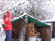 Dang snow - it's threatening my so-called woodshed.