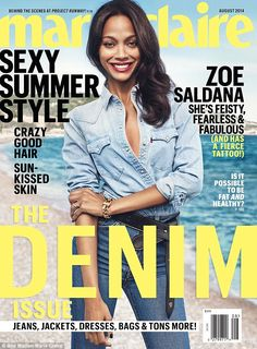 It's in the jeans: Zoe poses in a denim shirt and trousers teamed with belt on the cover of the magazine's August issue