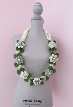 Beautiful money lei made with money flowers. Perfect for graduations, weddings, and more!